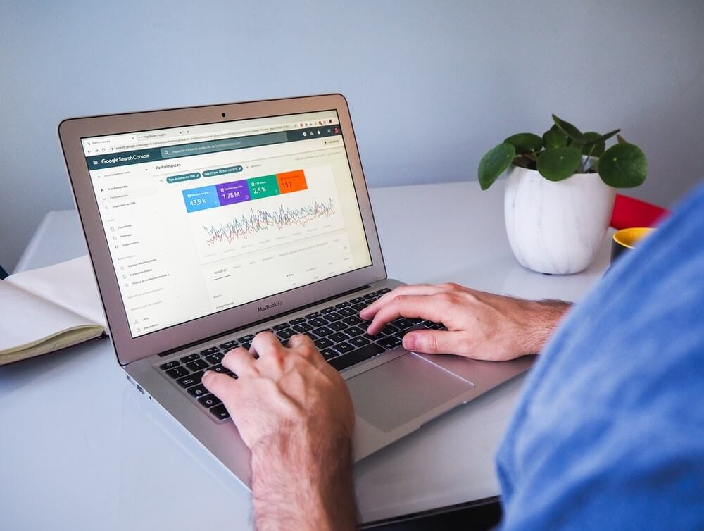 Person reviewing organic performance on a laptop